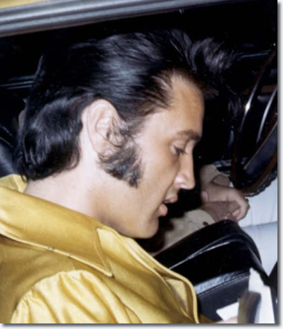 Elvis Presley in the driveway of his Hillcrest home, leaving for a rehearsal at RCA studios in July 1969