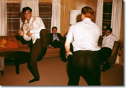 Elvis Presley and Red West practice Karate
