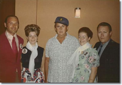 Members of 'The King's Court' fan club from New York with Colonel Parker backstage in Las Vegas on August 31, 1973