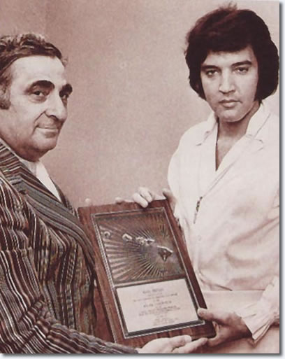 Elvis Presley : Receiving an award, January 13, 1973, before his Aloha Concert.
