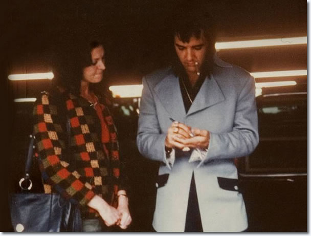 Elvis Presley, signing an autograph for a fan in Las Vegas on January 22, 1973
