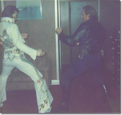 Elvis Presley : Detroit : Friday, October 4, 1974, karate pss with police officer.