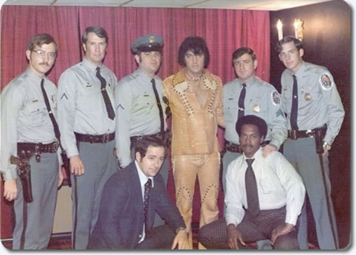 Elvis backstage on September 27/28, 1974 with police officers who were proud to 'pose' with the King. The gentleman below right, is one of Elvis' friends, 'Smokey Joe' Thompson.