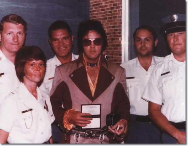 Elvis Presley with local police before boading his plane to leave Greensboro for Asheville, North Carolina.