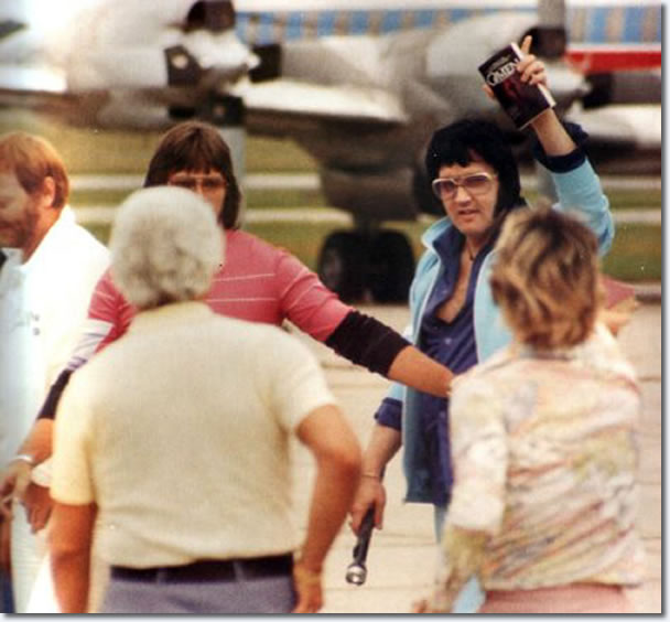 Elvis Presley departing the Lisa Marie with Linda Thompson in Shreveport on July 1, 1976 (also in the photo is Sonny West)
