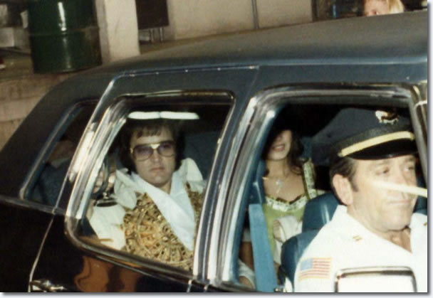 Elvis, heading to perform via the hotel back entrance in Macon, GA on June 1, 1977