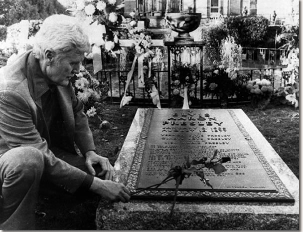 Vernon Presley, Elvis Presley's father, places a rose on his son's grave Nov. 24, 1977, as newspeople were permitted inside the grounds at Graceland in Memphis, Tenn., for the first time since Elvis' funeral.