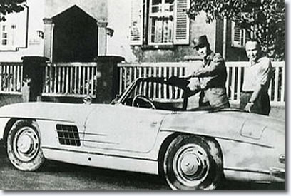 Elvis and Hal Wallis Standing next to a Mercedes-Benz sports car (type: 300 SL).
