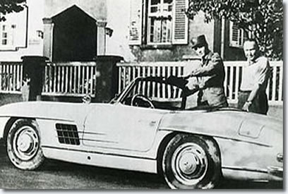 Elvis and Hal Wallis Standing next to a Mercedes-Benz sports car (type: 300 SL)