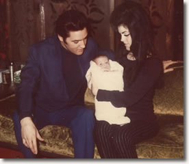 Elvis and Priscilla with baby Lisa Marie at home