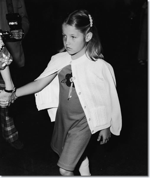"A nine year old Lisa Marie doesn't look too happy in this photo. Her parents Elvis and Priscilla had divorced roughly four years earlier. Though Priscilla took most of the responsibility in raising their daughter, Lisa Marie did spend a lot of time at Graceland with her father. Here she attended the first ever ""Children's Premiere"" benefit for the Thalians Community Mental Health Center at Cedars Cinai Medical Center in Los Angeles in March 1977, just months before her father would die in front of her on the bathroom floor."