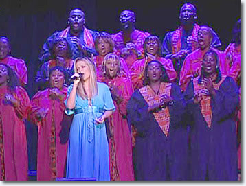 Lisa Marie performed 'In the Ghetto' with the Harlem Gospel Choir and vintage footage of her father, Elvis Presley.