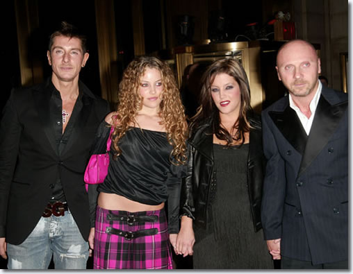 This picture is from 2003. Presenter Lisa Marie and her daughter Riley Keough pose with designers Stefano Dolce and Domenico Gabbana at The Fashion Group International's 20th Annual Night of Stars Awards Gala in New York City. Riley is reportedly dating Ryan Cabrera. In February 2004, Danielle made her modeling runway debut for designers Dolce & Gabbana in Milan. More recently she has made a video for Dior Perfume and modeled for Victoria's Secret. The mother and daughter duo were fodder for tabloid headlines when Lisa Marie was snapped holding her daughter's hair to facilitate a makeout session.