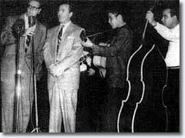 Elvis and Tommy Edwards at Brooklyn High School on October 20, 195