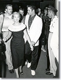 Elvis arrived at the station with his parents, Anita, and his male friends, George Klein, Cliff Cleaves and Lamar Fike