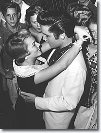 Making no secret of their affection for each other, Elvis and Anita Wood look into each others eyes like any other lovers bidding farewell