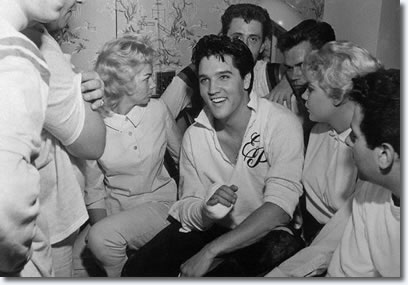 Elvis breaks his finger playing touch football at Graceland, Elvis visits a hospital and goes home after spending one night, declaring 'I Don't Have Any Business in a Hospital'