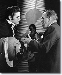 Elvis Presley talks with Ed Sullivan