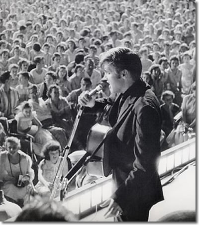 Elvis on stage at Russwood - July 4, 1956.