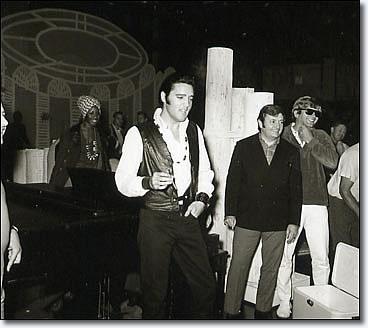 Elvis Presley sings Parody lyrics of 'It Hurts Me'.