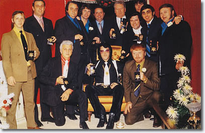 Here was a picture taken with Elvis and all the guys displaying the badges they too had just received from Sheriff Nixon.