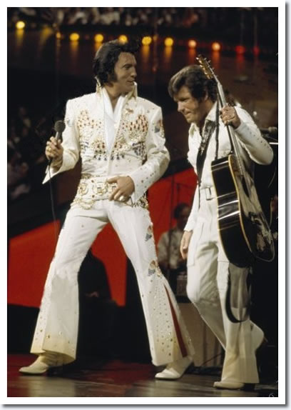 January 14, 1973 : 'Aloha from Hawaii' : Elvis Presley and Charlie Hodge.