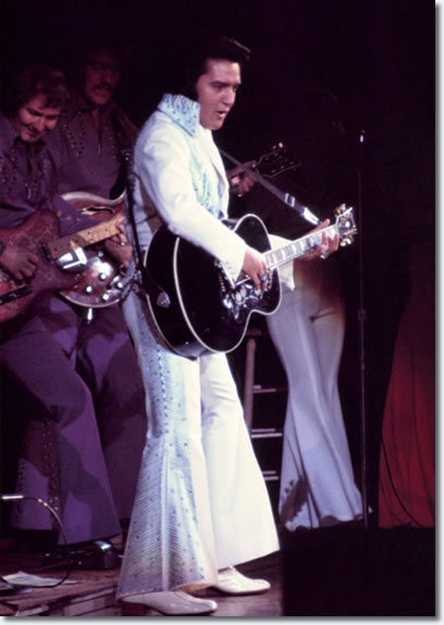 This photo is from June 28, 1974. Elvis is wearing the rare Aqua Blue Phoenix jumpsuit.
