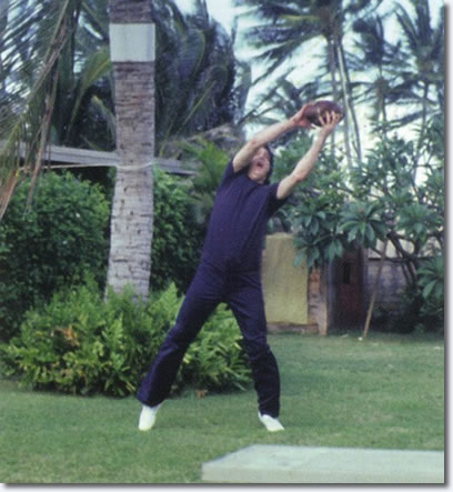 Elvis having fun playing Football in Hawaii March 1977